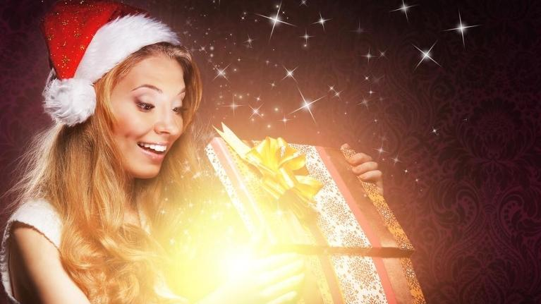 woman with beautiful smile and christmas gift